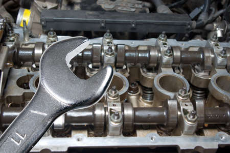 car engine and spanner. Focus on spanner.Working on a Car