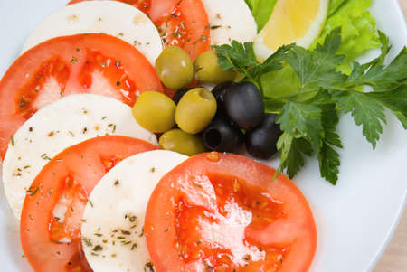 Arrangement of mozzarella and tomatoes.Italian kitchen. photo