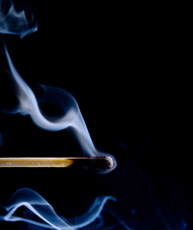 Wooden match burning on a black background Stock Photo - 4621287