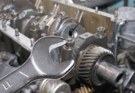 car engine and spanner. Focus on spanner.Working on a Car Stock Photo - 4655675