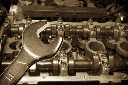 Repair of the engine. Focus on spanner.Working on a Car Stock Photo - 4848110