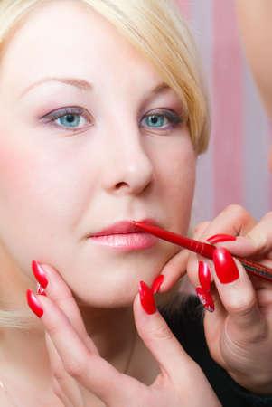 visagiste: Which girl of a lip paints visagiste  red  lipstick.