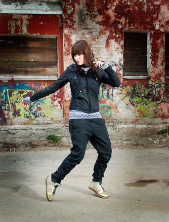 stylish and cool hip hop style dancer posing  photo
