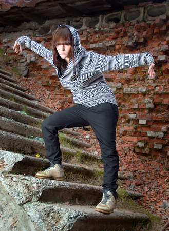 Hip hop female performing and act over an urban background Stock Photo - 4921860