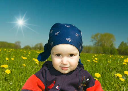 boy on meadow with dandelion.small child photo