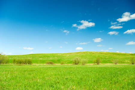 Scenic picture of a meadow with impressive sky at the background Stock Photo
