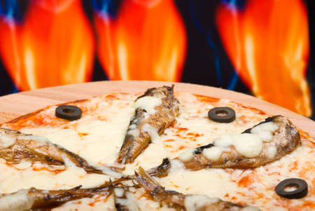 fervour: Pizza and italian kitchen with fire on background Stock Photo