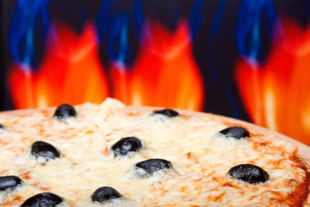 fervour: Pizza  with fire on background. close up
