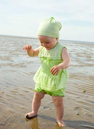 Little baby girl on the beach .White Sea Stock Photo - 5420660