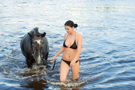 young girl bathe horse in a river. Stock Photo - 5467025