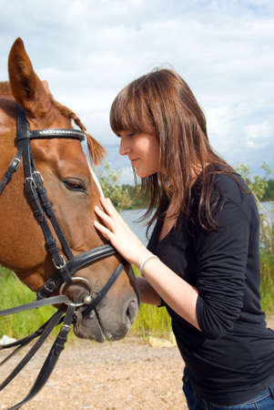 beautiful girl and horse.romantic scene photo