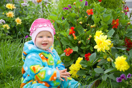 baby considers flower.small girl photo