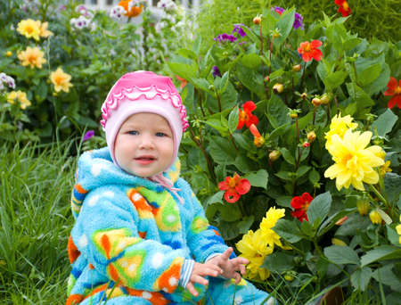 considers: baby considers flower.small girl