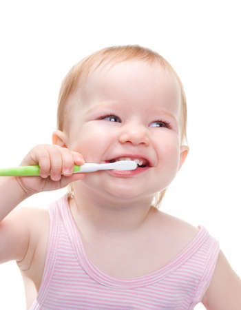 Girl with toothbrush  isolated on a white background.  Stock Photo