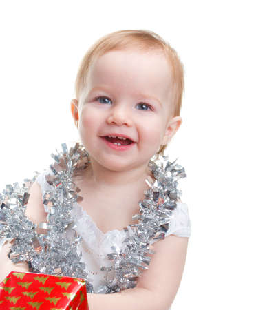 attribute: Image cute baby with Christmas decoration over white background  Stock Photo