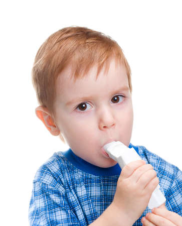 child with inhaler does medicine procedure  .isolated on a white background. photo