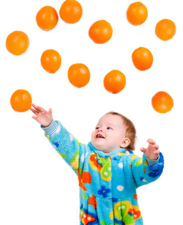 Little baby girl caughts orange .isolated on white background Stock Photo - 6075373