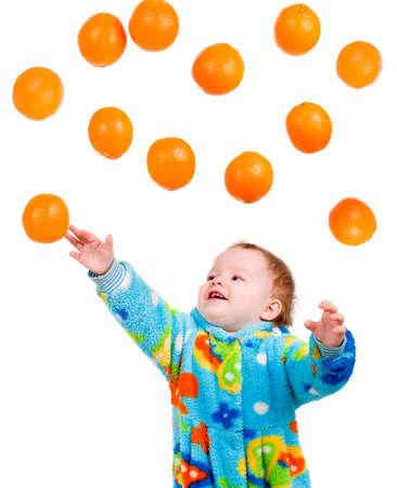 Little baby girl caughts orange .isolated on white background Stock Photo - 6075373