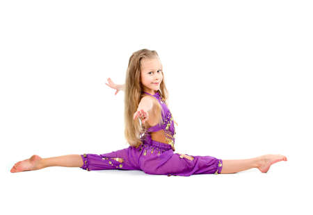 young girl doing gymnastics over white  Stock Photo