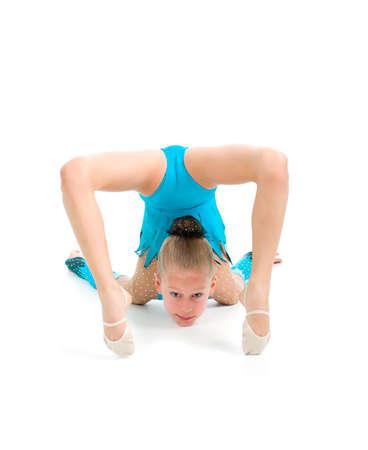 little girl makes gymnastic over white background Stock fotó - 6134014