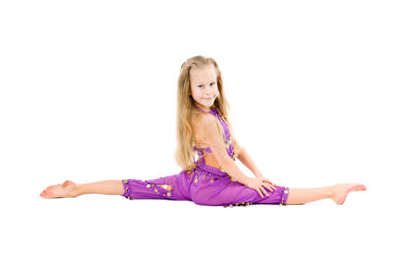 little girl makes gymnastic over white background  photo