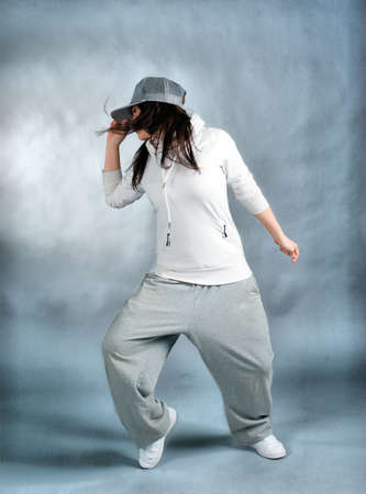 modern style dancer posing on  gray background  photo