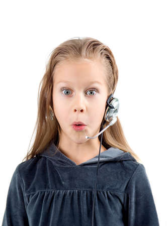 7 year old girl: shocked little girl with headset. White background.