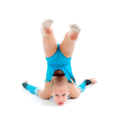 little girl makes gymnastic over white background  Stock Photo - 6163750