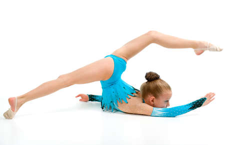 Gymnast girl in flexible back pose  over white