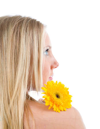 Fashion portrait of a beautiful blonde girl with flower.Isolated on white background  Stock Photo - 6262168