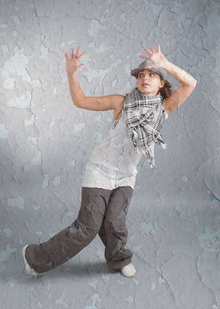 Hip hop female performing on  gray background photo