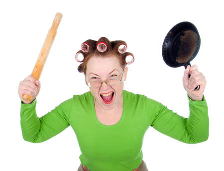 Woman in hair rollers is holding . Very frustrated and angry mad woman. Angry look on face. Studio, white background.