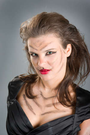 cat woman .girll in cat make-up and bodyart photo