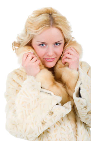 pretty model wearing fur coat  Isolated on white backgroun Stock Photo - 6517277
