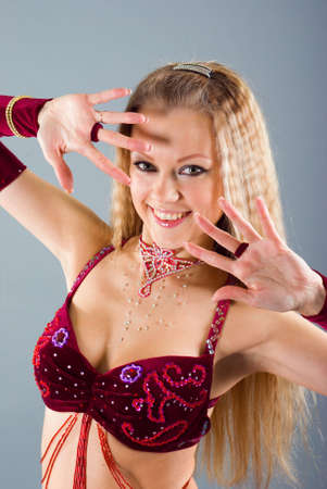 Attractive woman performing arabic dance photo