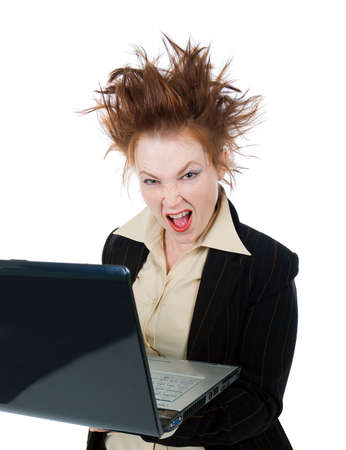 Angry crazy Businesswoman with a laptop - isolated on white photo
