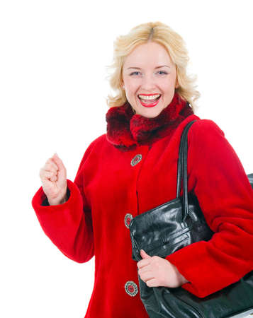 Portrait of  beautiful girl in a red fur coat with stylish bag Stock Photo - 6533973