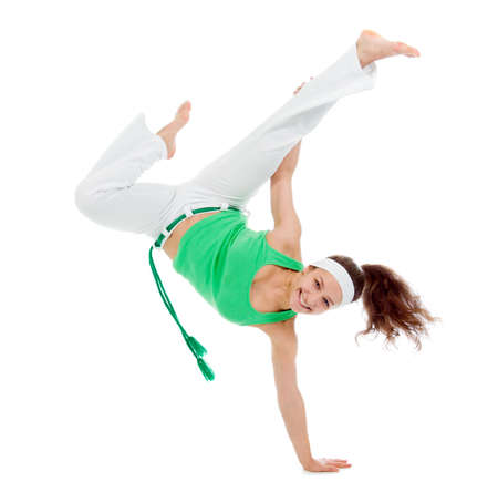 girl  capoeira dancer posing  over white background  Stock Photo