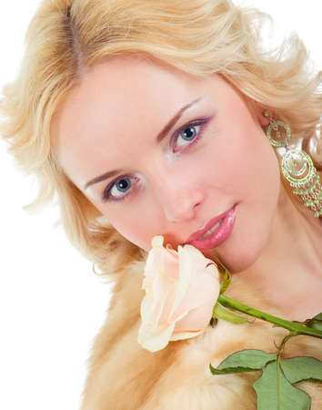 pretty model wearing fur coat with rose Isolated on white backgroun photo