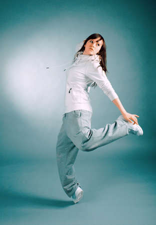 modern style dancer posing on  gray background  photo