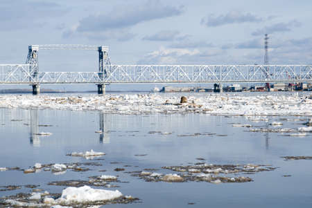 Driving of ice on river.spring landscape,port taps photo