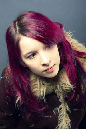 Emo look   girl with red hair on  gray background Stock Photo - 6900562