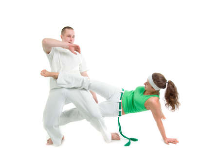 Contact Sport .Capoeira.over white background  photo