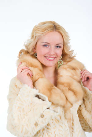pretty model wearing fur coat  Isolated on white backgroun photo