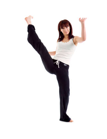 girl  capoeira dancer posing  over white background  photo