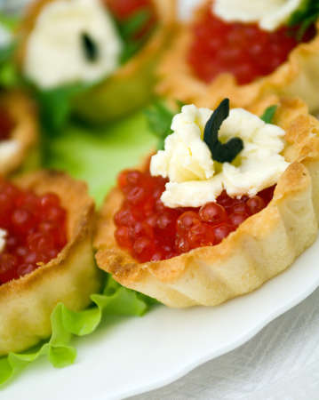 Canapes with red caviar   . Shallow depth-of-field photo