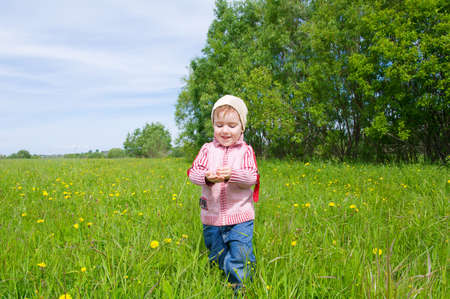 boy and  ladybird  on meadow with dandelion Stock Photo - 7613113
