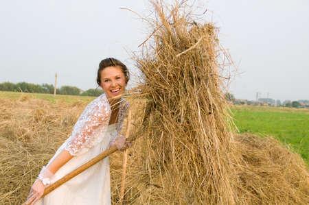 haymow: country romantic bride on haystack.