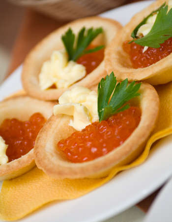 Tartlet with red caviar   . Shallow depth-of-field photo