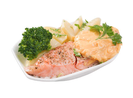 stake: Stake from a salmon with vegetables on a plate. Closeup.isolated on a white background.